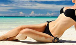 Picture of a girl on a beach showing her trimmed abdomen.