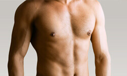 Picture of a male chest showing the results of a Gynecomastia procedure.