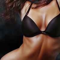 Close-up picture of a slender woman's breasts, displaying the breast lift with reduction procedure she had in Costa Rica.