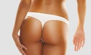 Close-up picture of a slender woman's buttocks, displaying the buttocks reduction procedure she had in Costa Rica.