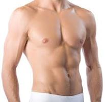 Picture of man with his shirt off, showing the male breast reduction procedure he had in Costa Rica.