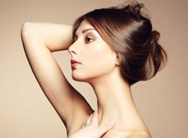 Profile close-up picture of a woman's face showing the neck and chin liposuction procedure she had in Costa Rica.