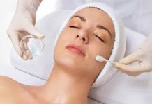Picture of a woman lying on her back showing a doctor giving her a chemical peel treatment she had in Costa Rica.