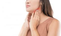 Picture of a woman holding both hands to her jaw showing the area of the holistic jaw osteonecrosis treatment she had.