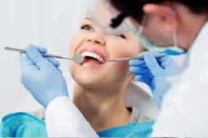 Picture of a smiling woman showing her happiness with the holistic oxygen-ozone therapy treatment she is receiving.