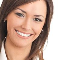 Picture of a smiling woman displaying the pure porcelain veneers procedure she had in Costa Rica.